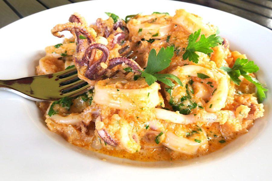 кальмари у сметанному соусі